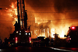 Firefighter - Firefighters and fire apparatus at the scene of a factory fire in Grand Rapids, Michigan.