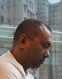 A serious-looking Firoz Mahmud in profile