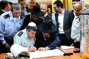 Inauguration of a Torah scroll - Israeli Chief of General Staff Gabi Ashkenazi is honored with the writing of the final letters in a Torah scroll dedicated to the welfare of missing or kidnapped IDF soldiers at the Rabin Base in Tel Aviv, 2010