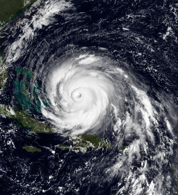 A view of Hurricane Floyd from Space on September 13, 1999. The storm is mature and well-defined, with a pronounced eye feature. Floyd is located over the Atlantic Ocean, and to the north and east of Cuba and Florida, respectively.
