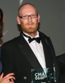 Fraser Patterson collecting the 2006 CMA Interbuild award..png