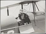 Freda Thompson sitting in the cockpit of a de Havilland DH.60G-III Moth Major, ca 1935 (15667323864).jpg
