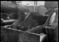 Garratt locomotive frames at the Hutt Railway Workshops, showing accumulated dirt ATLIB 311328.png