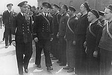 In this photograph, King George VI is inspecting the crew of the Norwegian ship HNoMS Draug, which was docked in Portsmouth sometime during the war.