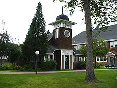 The shingle style clock house on the Greatwood Campus appears on the college seal.