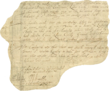 A small irregular section of parchment upon which several lines of handwritten text are visible. Several elaborate signatures bookend the text, at the bottom.