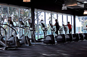 Elliptical trainer - Row of elliptical trainers at a gym (right)