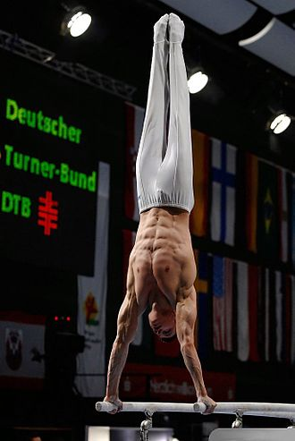 Parallel bars - A gymnast performs on the parallel bars