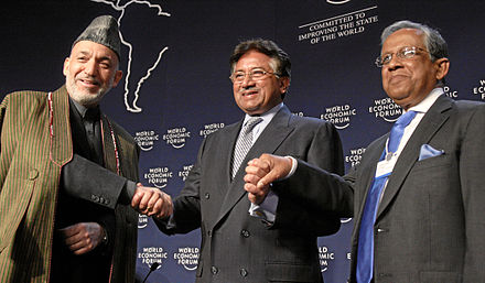 Economist Fakhruddin Ahmed (far right) led a caretaker government between 2007 and 2008 under a state of emergency Hamid Karzai, Pervez Musharraf, Fakhruddin Ahmed - WEF Annual Meeting Davos 2008.jpg