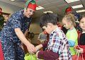Handing out gifts 131220-N-VK873-152.jpg