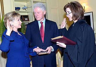 Clinton Cash - Hillary Clinton being sworn in as Secretary of State in 2009. Her husband and former U.S. President, Bill Clinton, holds the Bible.