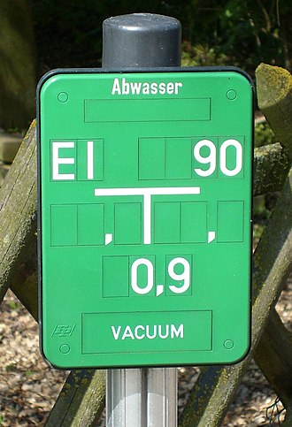 Vacuum sewer - Sign indicating a buried vacuum sewer in Germany.