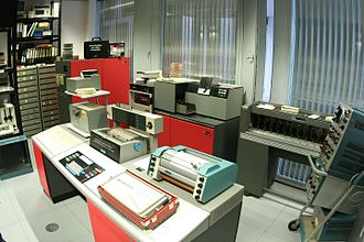 IBM 1130 - IBM 1130 with peripherals, including paper tape reader punch, IBM 1442 card reader/punch (rear) and IBM 1627 Calcomp plotter.