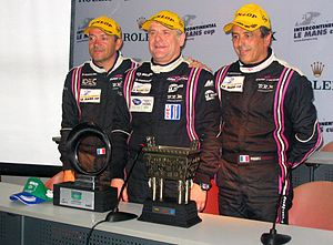Jacques Nicolet - Nicolet (centre) after winning the 2010 1000 km of Zhuhai with Patrice Lafargue (left) and Frédéric da Rocha.