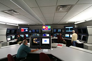 Space Weather Prediction Center - Forecasters inside the Space Weather Forecast Office of NOAA's Space Weather Prediction Center (SWPC) in Boulder, Colorado