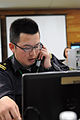 Japan Maritime Self-Defense Force Lt. Saito Naoki, a Japan Joint Task Force Maritime Component Commander liaison, works with U.S. Service members while commanding a simulated naval fleet during Yama Sakura (YS) 131207-A-TE537-025.jpg