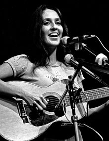 Black-and-white photograph of a woman with a guitar