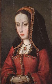 Una signora con un viso lungo e magro che indossa abiti rossi e un cappuccio nello stile di una suora.