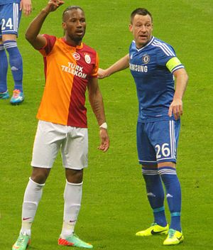 Defender (association football) - Centre-back John Terry (26, blue) closely marks centre-forward Didier Drogba.