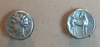 Carthaginian currency - A silver Carthaginian shekel bearing the wreathed head of Tanit and a standing horse before a palm tree and beside a star.