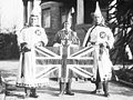 Keith K. Allen (left) and R. G. Wallace (center) with the Union Jack at Glen Brae - Ku Klux Klan Imperial Kouncil in Shaughnessy, British Columbia, 1925 (cropped).jpg