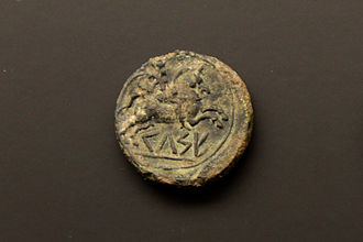 Celsa (Roman city) - Bronze coin minted in Kelse in the 2nd century BC, showing its name in the Iberian language