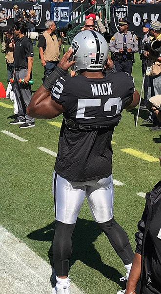 Khalil Mack - Mack warms up before a home game in 2015