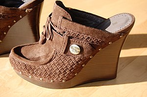 L.A.M.B. - A L.A.M.B. label wedge-heel shoe.