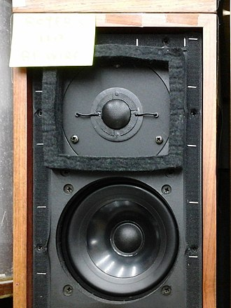 "Loudspeaker enclosure - A small LS3/5A ""bookshelf speaker"" with its protective cover removed."