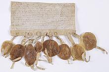 Photographie de la lettre circulaire adressée par les prélats et barons du royaume aux évêques et grands feudataires pour les inviter à assister au Couronnement du jeune Louis IX.