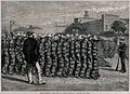 Lines of men in prisoner's uniform are marching towards a bu Wellcome V0041213.jpg