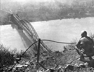 Battle of Remagen - Dan Feltner of Company C., 656th Tank Destroyer Battalion, views the Ludendorff Bridge from the top of Erpeler Ley.