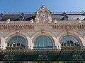 Lyon 6e - Gare des Brotteaux, haut de la façade avec l'horloge.jpg