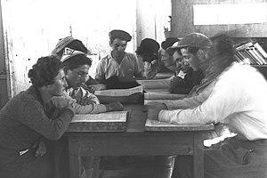 "Gemara - Image: MEMBERS OF ""KVUTZAT RODGES"" STUDYING THE ""GEMARA"". מתיישבים לומדים גמרא בקבוצת רודגס.D29 022"