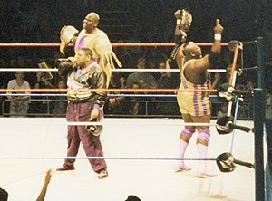 Mo (wrestler) - Mo (right) and Mabel (center) celebrating with Oscar (left) upon winning the WWF World Tag Team Championship in 1994.