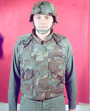 ERDL pattern - A man in 1975 modelling an early prototype of the PASGT vest in the brown-dominant ERDL pattern.