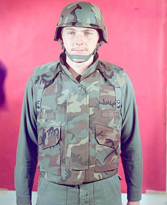 Personnel Armor System for Ground Troops - A man in 1975 modelling an early prototype variant of the PASGT helmet and vest in the ERDL pattern.