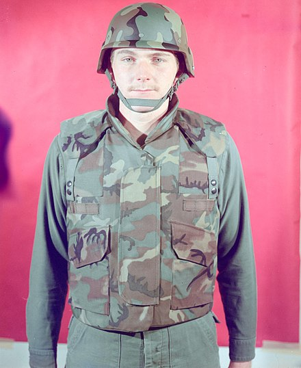 500738f1053 A man in 1975 modelling an early prototype variant of the PASGT helmet and  vest in