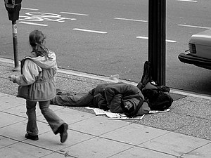 Homeless man resting on sidewalk. Vancouver, C...