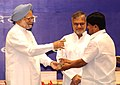 Manmohan Singh presenting the award for the best performing States under the Panchayat Empowerment & Accountability Incentive Scheme (PEAIS) to West Bengal, at the National Panchayati Raj Diwas, in New Delhi.jpg