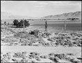 Manzanar Relocation Center, Manzanar, California. Looking down Inyo Valley toward Lone Pine from th . . . - NARA - 538042.tif