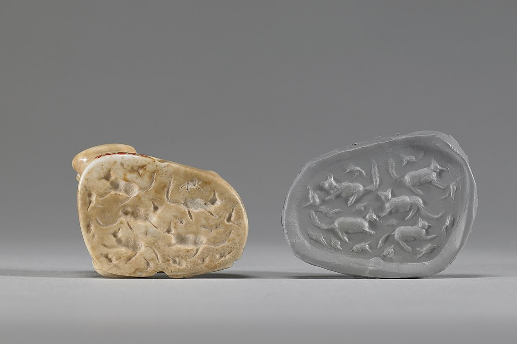 external image 1024px-Mesopotamian_-_Stamp_Seal_in_the_Form_of_a_Reclining_Calf_-_Walters_42540_-_Impression.jpg
