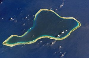 Low island - The Moruroa atoll, composed of low islands on the reef encircling a central lagoon.