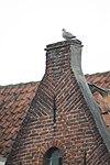 foto van Hoek Appelmarkt. Huis met bakstenen topgevel. Schuifraamkozijnen