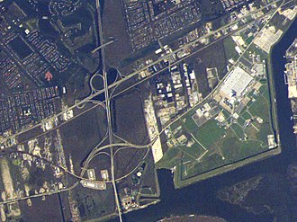 Michoud Assembly Facility - A section of eastern New Orleans after Hurricane Katrina. MAF (green) is not flooded, while the surrounding neighborhoods (dark greenish brown) are extensively flooded.