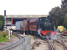 One of the museum's steam engines hauling a special train on the museum site - 3 ft 6 in gauge on right, 18 in gauge on left.