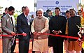Narendra Modi inaugurating the Multimodal Manufacturing Project of GE, in Pune. The Chief Minister of Maharashtra, Shri Devendra Fadnavis and the Minister of State for Environment.jpg