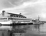 Naval Reserve Armory Seattle with USS Waxbill (AMS-39) circa in 1950.jpg