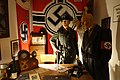 "Nazi Germany Reich service-Kriegsmarine flags, SS uniform-helmet-armlet, RAD table clock, telephone, prisoner uniform, etc. in ""Gestapo office"" at Lofoten Krigsminnemuseum, Norway 2019-05-08 DSC00172.jpg"