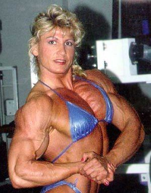 Female bodybuilding - Nikki Fuller performing a side chest pose